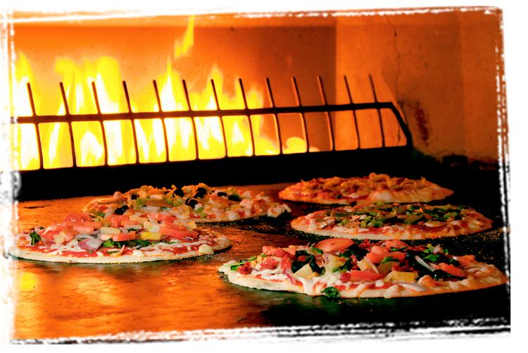PizzaRev bakes pizzas in a 900-degree open-flame stone bed ovens.