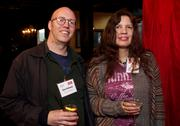 Dan Helland, left, of Nuova Simonelli and Gina Reinholz of Maxim Healthcare at the Faces of Sodo reception at Aston Manor in Seattle on Thursday.