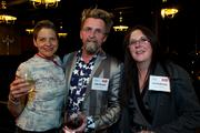 From left, Shelley, Billy Kincaid and Jodi Anderson of the Hooverville Bar during the Faces of Sodo reception at Aston Manor in Seattle on Thursday.