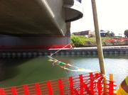 Workers stretched a fluttering ribbon across the waterway, which used to be enclosed in culverts.