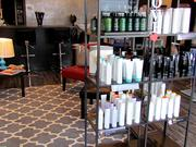 The salon includes a small retail section for Paul Mitchell products.