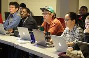From left, students Jerrold Thompson, Jonah Kirangi, Michael Elliott and Lillian Ng in a Code Fellows Ruby on Rails boot camp.