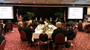 The crowd listens to five Central Florida mayors discuss the economic developments in their areas.