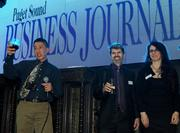 From left, Staff Photographers Anthony Bolante and Marcus Donner and Assistant Managing Editor Jenny O'Brien of the Puget Sound Business Journal during the Faces of Sodo reception at the Aston Manor in Seattle on Thursday.