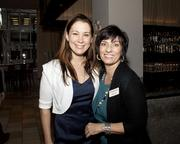 Business Journal events coordinator Megan White and account executive Deb Galvez pose at the Book of Lists party.