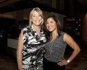 Michele Reesink of Glumac and Veronica Delgado of Kitchell pose at the Book of Lists party.