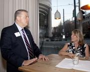 Ken Harms of Kitchell CEM and Michele Reesink of Glumac chat at the Book of Lists party.