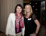 Jeannine Long of Brown Construction and Kari Shotwell of NCM Demolition and Remediation pose at the Book of Lists party.