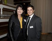 Diane Dean-Epps of Cook Brown LLP and Business Journal account executive Josh Michael pose at the Book of Lists party.