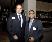 Jacob Flesher of Flesher McKague LLP and Indresh Chauhan of Merrill Lynch pose at the Book of Lists party.