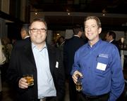 Michael Jones and Jim Dietler of Comcast Business pose at the Book of Lists party.