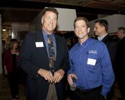 Christopher Barry of Windstream and Jim Dietler of Comcast Business pose at the Book of Lists party.