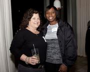 Joell Edwards of SureWest Foundation and Rhonda Staley-Brooks of Big Brothers Big Sisters pose at the Book of Lists party.