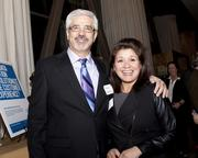 Vince Kaleel and Patti Kaleel of Owen Dunn Insurance Services pose at the Book of Lists party.