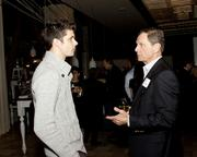 Russell Breton of Vision Launchers chats with Ron Clarke at the Book of Lists party.