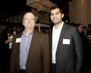 Pete Kreuser and  Kaushal Diwan of DPR Construction pose at the Book of Lists party.