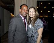 Leroy Tripette of Intel Corp. and Angelina Bravo of BSK Associates Engineers and Laboratories pose at the Book of Lists party.