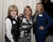 Debbie Struhm of Roebbelen Contracting, Michele Reesink of Glumac and Sheree Nelson of Republic Services pose at the Book of Lists party.