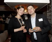 Ashley Oliver and Geoff Sharaky of Prudential pose at the Book of Lists party.