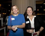 Laurie Ramirez of CORT and Annie Tautz-Schaubmayer of Schaubmayer Painting pose at the Book of Lists party.