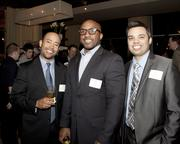 Jason King of Robert Half Technology, Albert Dennis of Give Something Back and Marcus Jankowski of Robert Half Accountemps pose at the Book of Lists party.