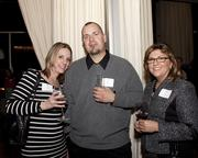 Lisa Davies of Innovative Maintenance Solutions, Johnny Cummings of Innovative Maintenance Solutions and Liz Mack of Sutter Health Plus pose at the Book of Lists party.