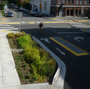 Bioswale construction is often paired with improved bicycle infrastructure.