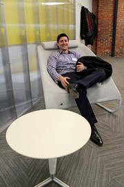 Piero Ferrante, manager of analytics and insights for Blue Cross and Blue Shield of Kansas City, sits in one of the accelerator's many ergonomic seats.