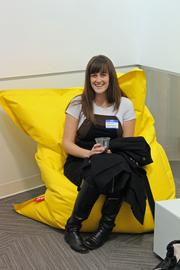 Kaitlin Motley, marketing specialist with KCNext, tests out one of the Fatboy bean bag chairs.