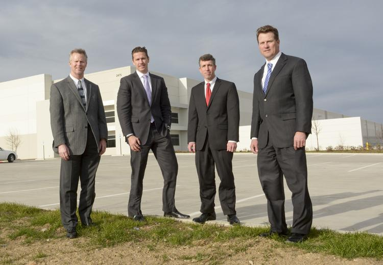 From left to right: Robert Brandt, Trammell Crow Co., Steve Trese, CBRE, Jake Marks, CBRE, Scott Krikorian, at Trammell Crow Co.'s Irving headquarters.