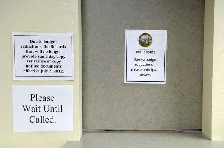 Signs at the Sacramento County courthouse warn customers about delays.