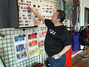 Respect Your Universe CEO Dave Campisi looks over storyboards for the brand's 2014 product line.