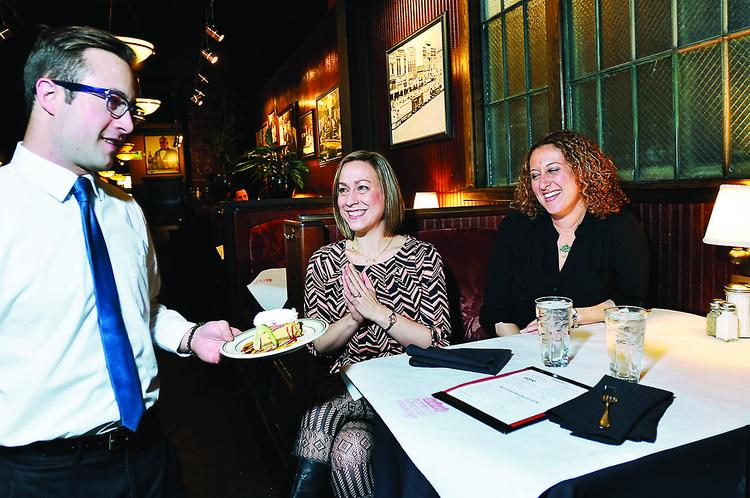 Sarah Hogan and Cori Streetman, of Barefoot PR, at the ChopHouse, which donated Key lime pie proceeds to Barefoot's client Mercy House.
