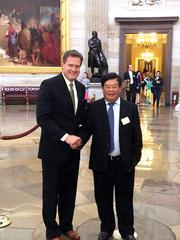 Creating Deals: U.S. Rep. Mike Turner and Dewang Cao, chairman of Fuyao.