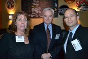 From left, Amy Yendall of Payroll Network Inc., Jeff Ouellette of Burdette Smith & Bish CPAs, and Justin Silvers of EagleBank, at the Washington Business Journal's BizMixer happy hour.