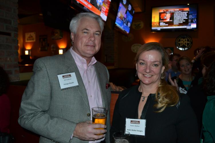 The Washington Business Journal shook off the cold and hosted its first BizMixer of the year Jan. 15 at the World of Beer in Ballston. From left, Bill DuBose of Vintage Wealth and Robin Walker of Robin Walker Designs.