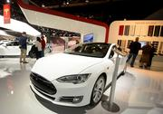 The Tesla Motors Inc. Model S sedan is displayed during the 2014 North American International Auto Show (NAIAS) in Detroit, Michigan, U.S., on Tuesday, Jan. 14, 2014. Tesla Motors Inc., the maker of high-end electric cars, gained the most in six weeks after the carmaker said it delivered 6,900 Model S sedans in the fourth quarter, pushing full-year sales beyond a company target. Photographer: Daniel Acker/Bloomberg