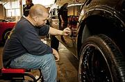 It's all fun and games at the 2014 New England International Auto Show. Here, Kevin Kellie of Toy Motor Sports spruces up a vehicle before the show opens to the public.