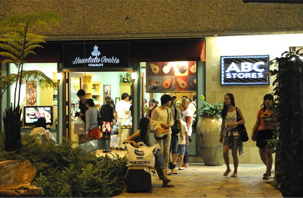 Visitors crowd into stores in Waikiki in this 2013 file photo. A record 8.3 million visitors came to Hawaii in 2013, and spent a record $14.5 billion, according to preliminary figures from the Hawaii Tourism Authority.