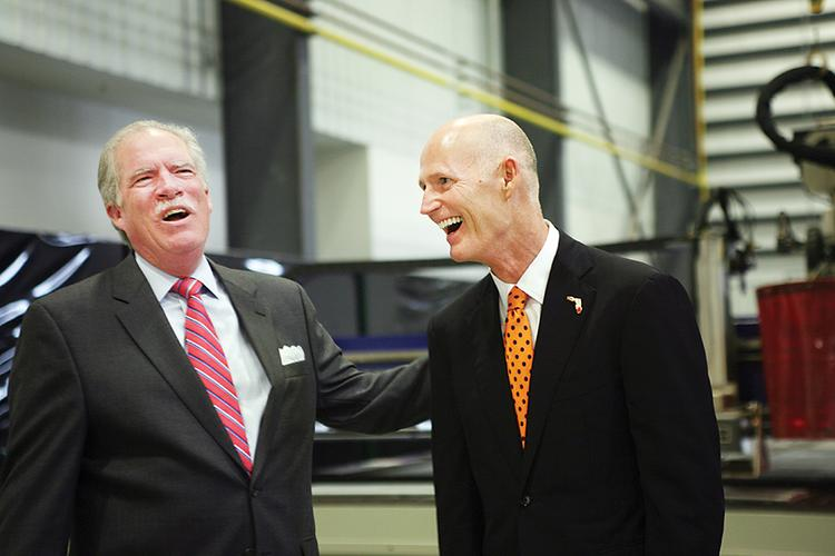 At Air Products and Chemicals' grand opening celebration in Palmetto across from Port Manatee, company President and CEO John McGlade interacts with Gov. Rick Scott.