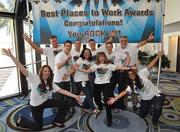Employees of CompHealth show their pride.