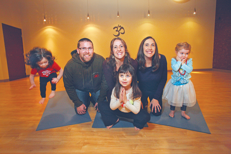 Jon (left) and Jamie Hopkins, and Jessica McClintic (right), all siblings, decided to franchise their children's yoga business. Today they have 12 franchisees.