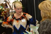 Shawna Sphar with Candela at The Lux speaks with a guest at the Meet Wichita Expo Thursday at the Mid-America All Indian Center, 650 N. Seneca St.