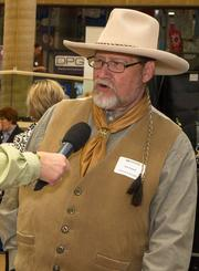Jim Farrell of Diamond W Wranglers, a Kansas western music group, gives some quick info about their music to a Go Wichita representative at the Meet Wichita Expo Thursday at the Mid-America All Indian Center, 650 N. Seneca St.