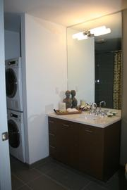 """The bathroom with washer/dryer at at """"315 on A."""""""