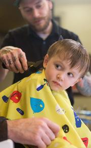 Though they cater to men, the Old Bank Barbers also do women's and children's hair, such as 3-year-old Jack Noorbakhsh.