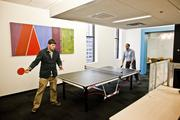 Cameron West, left, and Jared Burke of Paramore battle it out in a game of ping-pong.