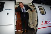 Ronald Brown of the University of North Texas at Dallas disembarks a Bombardier Learjet cabin.