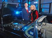 Allen and Debbie Baker admire a 1960 Chevrolet Corvette on display at the DBJ's Book of Lists reception at Starbase in Addison.
