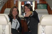 """Cass Roberts, right, and Kelly, of Ricochet Fuel take a """"selfie"""" inside a Learjet."""